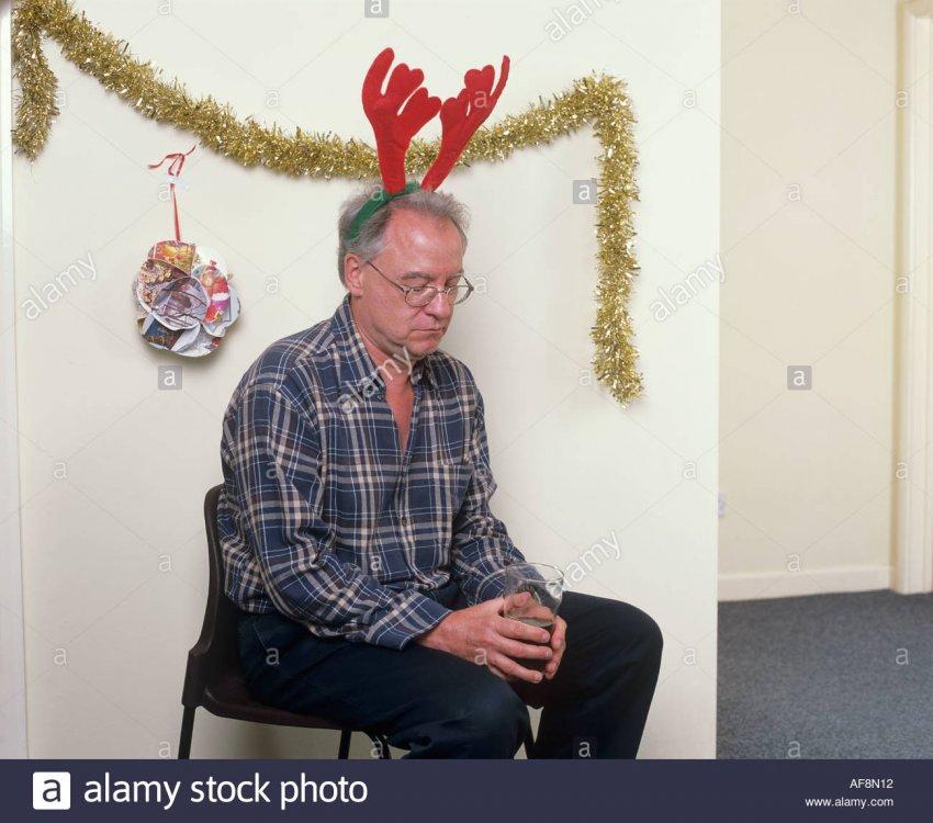 man-alone-at-christmas-party-wearing-antlers-AF8N12.jpg
