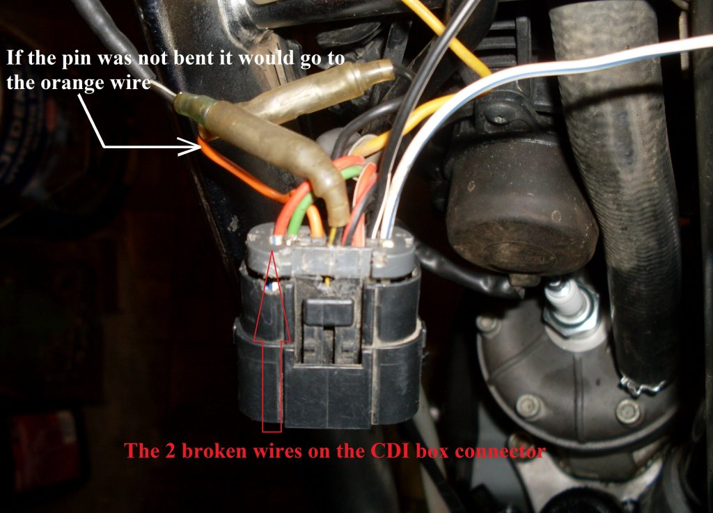 Pic 2. If the pin was not bent it would go to the orabge wire (marked with a arrow).JPG